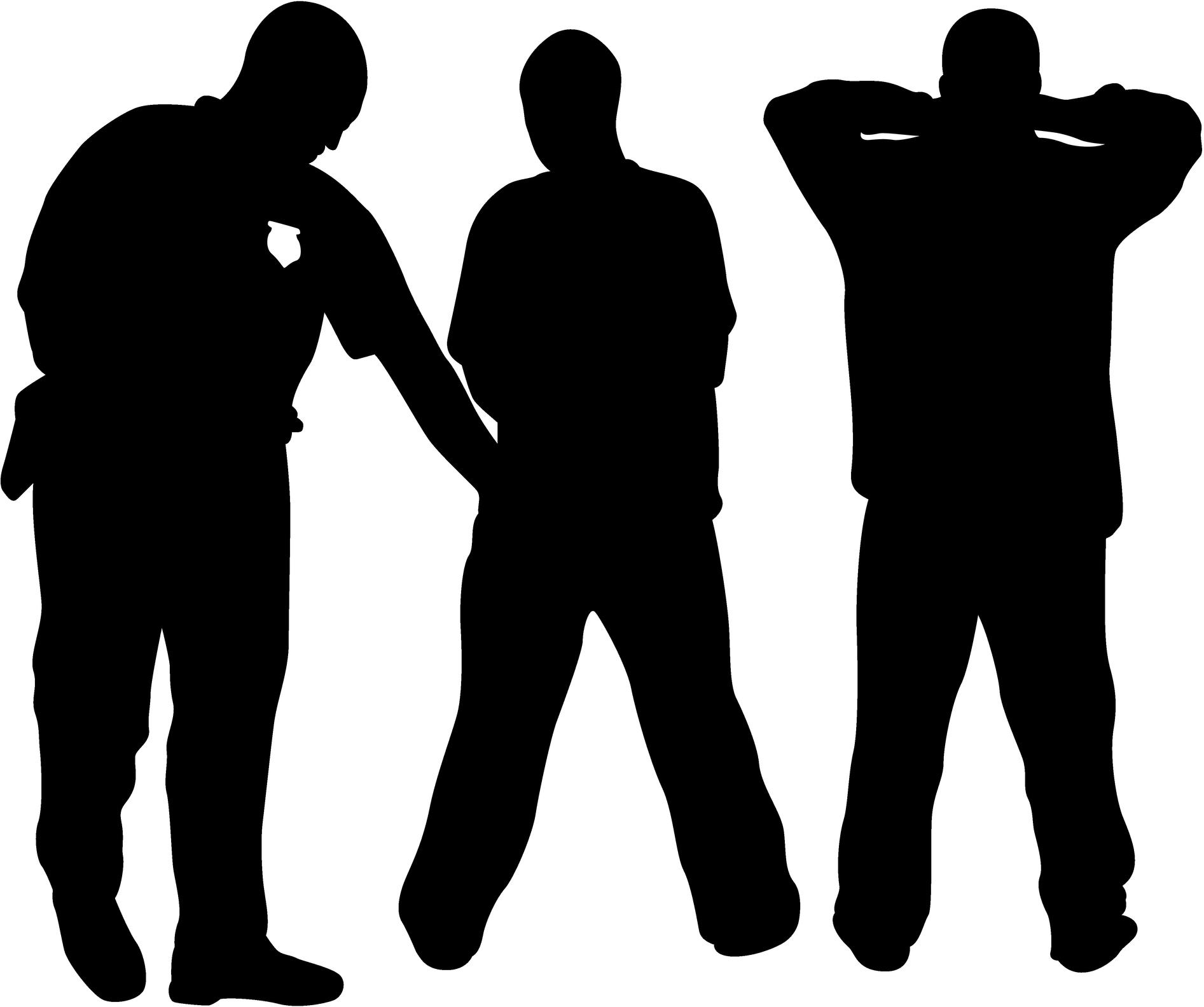 Silhueta de homens sendo revistados por segurança